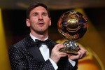 messi-picking-up-his-fourth-ballon-dor-300x200